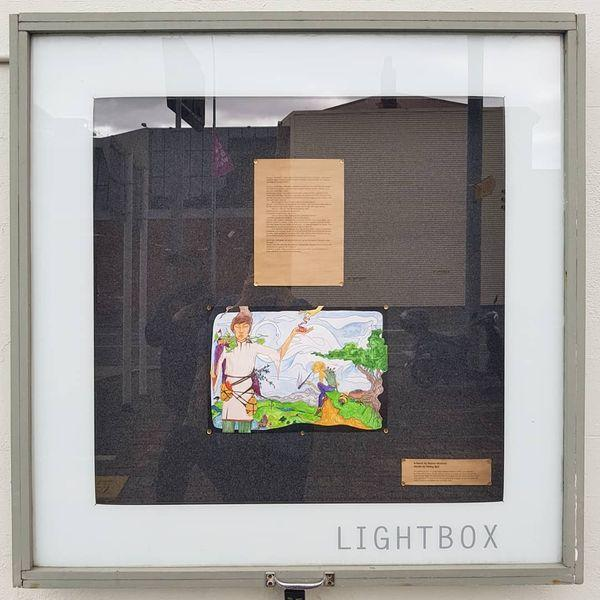 photo of artwork and words in lightbox