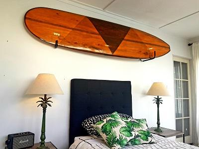 surfboard above fireplace